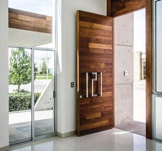 Merino experience, custom design, custom home, design and build, luxury home, luxury home builder, best practice builder, MBA builder, HIA builder, green smart professional, builders in Macarthur, builders in Camden, builders in Bowral, Southern highland builders, building a home, top 10 builders, custom builders, local builder, architectural designed homes, Builders in Moss Vale, luxury design, front door, house number handle, entryway, wood